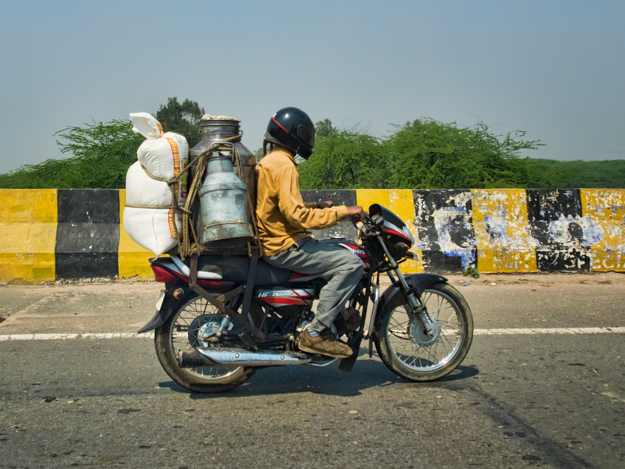 Motorcycle Milk and Rice Delivery, India