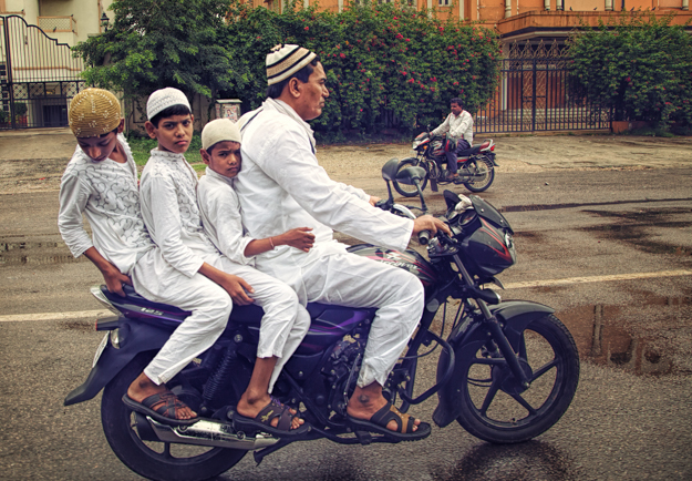 Family on a Motorcycle Dressed for Mosque