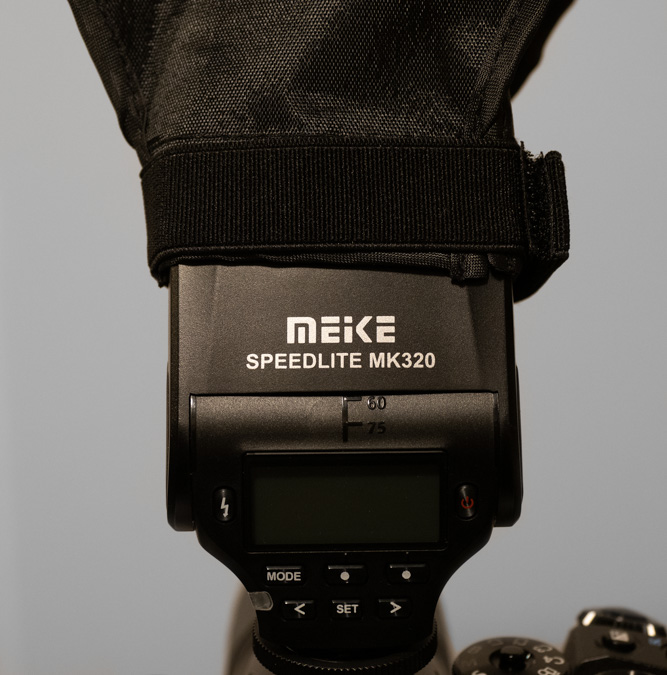 Meike MK320 with Softbox Attached