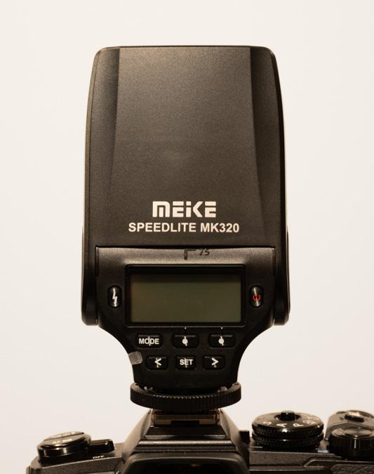 Meike MK320 on an Olympus OM-D E-M1 III